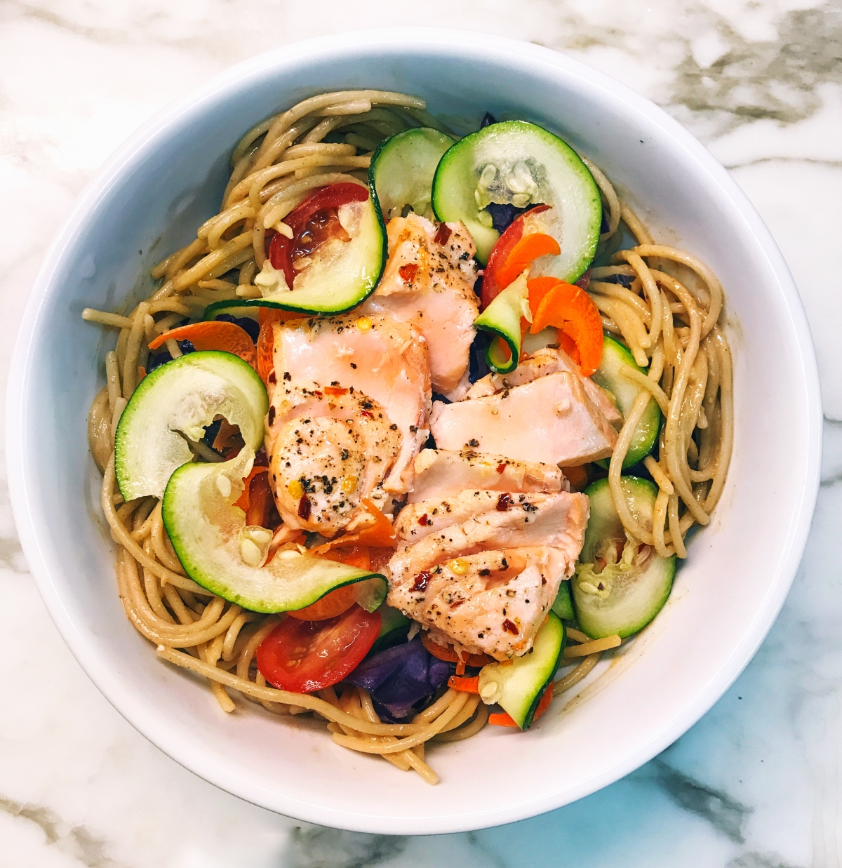 Brown Rice Noodles in a Creamy Nut Sauce with Vegetables and CoconutSalmon