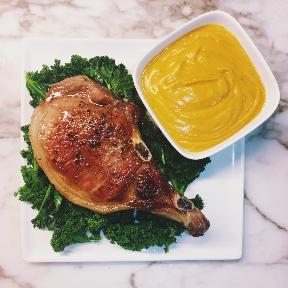 Butternut Squash Soup with Pan Seared Pork Chop and CrispedKale
