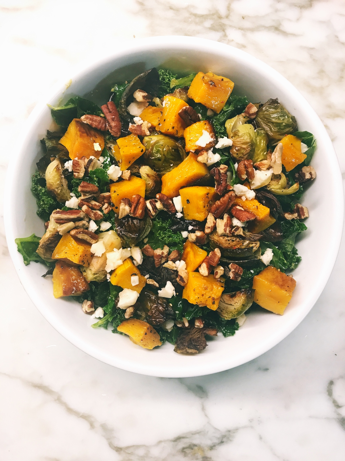 Autumn in a Bowl: Kale Salad w/ Roasted Butternut Squash & Brussel Sprouts, Pecans, and Goat Cheese