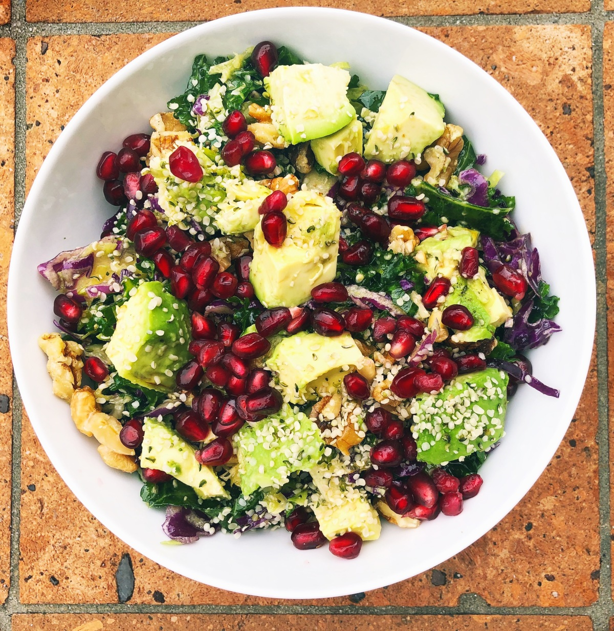 Kale Tahini Salad with Avocado, Pomegranate, and Walnuts